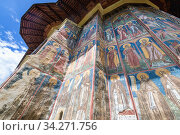 Close up on paintings on Moldovita Monastery - Romanian Orthodox monastery located in commune of Vatra Moldovitei, Suceava County, Romania. Стоковое фото, фотограф Konrad Zelazowski / age Fotostock / Фотобанк Лори