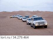 Driving in the dunes, Dubai. Photo: André Maslennikov. Стоковое фото, фотограф Andre Maslennikov / age Fotostock / Фотобанк Лори