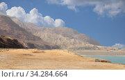 Купить «Rocks Wadi Mujib against the background of moving clouds -- national park located in area of Dead sea, Jordan», видеоролик № 34284664, снято 3 августа 2020 г. (c) Владимир Журавлев / Фотобанк Лори