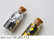 silver and gold glitter in bottles on white. Стоковое фото, фотограф Syda Productions / Фотобанк Лори