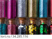 set of different glitters in small glass bottles. Стоковое фото, фотограф Syda Productions / Фотобанк Лори
