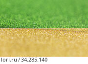 green and golden glitters or sequins backgrounds. Стоковое фото, фотограф Syda Productions / Фотобанк Лори