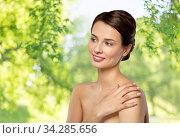 beautiful young woman touching bare shoulder. Стоковое фото, фотограф Syda Productions / Фотобанк Лори