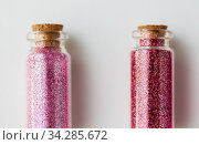 red glitters in bottles over white background. Стоковое фото, фотограф Syda Productions / Фотобанк Лори