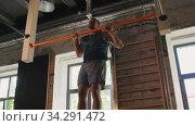 Купить «man exercising on bar and doing pull-ups in gym», видеоролик № 34291472, снято 11 июля 2020 г. (c) Syda Productions / Фотобанк Лори