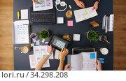 Купить «business team with gadgets working at office table», видеоролик № 34298208, снято 7 июля 2020 г. (c) Syda Productions / Фотобанк Лори