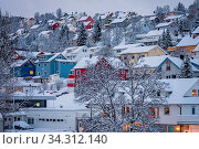 Residential hillside houses in Tromso suburb covered in a deep snow in winter, northern Norway. Стоковое фото, фотограф Zoonar.com/Pawel Opaska / easy Fotostock / Фотобанк Лори