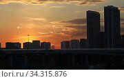 Купить «Sunset Over A Modern City, Sun Falls For Horizon. Time Lapse of Moscow city sunset, Russia», видеоролик № 34315876, снято 28 июля 2020 г. (c) Алексей Кузнецов / Фотобанк Лори