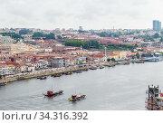 View of the Vila Nova de Gaia with the Rio Duoro River  from Dom Luis I bridge, Porto, Portugal. Редакционное фото, фотограф Николай Коржов / Фотобанк Лори
