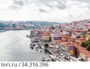 View of the historic town centre of Porto with the Rio Duoro River  from Dom Luis I bridge, Porto, Portugal. Стоковое фото, фотограф Николай Коржов / Фотобанк Лори