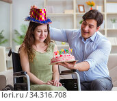 Young family celebrating birthday with disabled person. Стоковое фото, фотограф Elnur / Фотобанк Лори