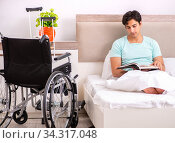 Young handsome disabled man recovering at home. Стоковое фото, фотограф Elnur / Фотобанк Лори