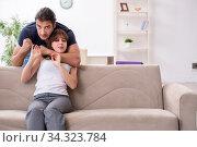 Young couple in domestic violence concept. Стоковое фото, фотограф Elnur / Фотобанк Лори