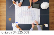 business team with blueprint working at office. Стоковое видео, видеограф Syda Productions / Фотобанк Лори