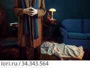 Male detective in gloves, victim under the cape. Стоковое фото, фотограф Tryapitsyn Sergiy / Фотобанк Лори