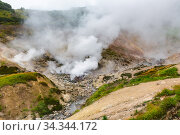 Breathtaking scenery view of volcanic landscape, aggressive hot spring, eruption fumarole, gas-steam activity in crater of active volcano. Стоковое фото, фотограф А. А. Пирагис / Фотобанк Лори