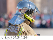 Back view of inscription Fire on uniform firefighter Emercom of Russia, Ministry of Civil Defence, Emergencies and Disaster Relief Russian Federation MChS (2019 год). Редакционное фото, фотограф А. А. Пирагис / Фотобанк Лори