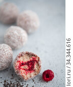 Raw lamington bliss balls with raspberries chia jam. Стоковое фото, фотограф Ольга Сергеева / Фотобанк Лори