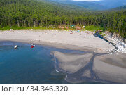 Beach and river estuary, boreal forest in background, aerial view. Camp on beach, gathering to watch Bowhead whale (Balaena mysticetus) congregation. Vrangel Bay, Primorsky Krai, Russia. August 2019. Стоковое фото, фотограф Franco  Banfi / Nature Picture Library / Фотобанк Лори