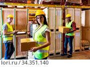 Portrait of caucasian white woman warehouse worker hold parcel box... Стоковое фото, фотограф Zoonar.com/Vichie81 / easy Fotostock / Фотобанк Лори