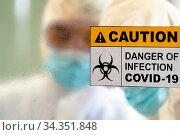 Caution danger Signage of COVID-19 coronavirus in front of Laboratory... Стоковое фото, фотограф Zoonar.com/Vichie81 / easy Fotostock / Фотобанк Лори