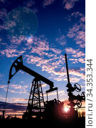 Oil pump rig. Oil and gas production. Oilfield site. Pump Jack are... Стоковое фото, фотограф Zoonar.com/BASHTA / easy Fotostock / Фотобанк Лори
