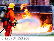 Firefighter using Chemical foam fire extinguisher to fighting with... Стоковое фото, фотограф Zoonar.com/Vichie81 / easy Fotostock / Фотобанк Лори