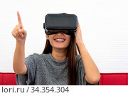 Asian teen beautiful girl woman touching air during playing VR video... Стоковое фото, фотограф Zoonar.com/Vichie81 / easy Fotostock / Фотобанк Лори