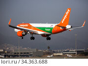Airline EasyJet plane comes in for a landing in an aeroport El Prat city of Barcelona. Board number OE-IVT (2020 год). Редакционное фото, фотограф Яков Филимонов / Фотобанк Лори