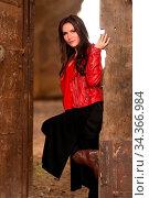 Fashion concept portrait of a gorgeous young woman sitting in a door... Стоковое фото, фотограф Zoonar.com/Arthur Mustafa / easy Fotostock / Фотобанк Лори