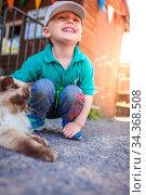 Portrait of a happy little boy stroking cat fur on the farm. Стоковое фото, фотограф Zoonar.com/Pawel Opaska / easy Fotostock / Фотобанк Лори