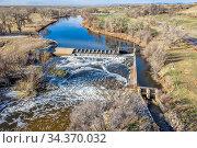 Water diversion dam on the South Platte River abover Brigthon, Colorado... Стоковое фото, фотограф Zoonar.com/Marek Uliasz / easy Fotostock / Фотобанк Лори