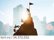 Concept of teamwork with team climbing mountain top. Стоковое фото, фотограф Elnur / Фотобанк Лори