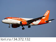 EasyJet Europe Airbus G-EZFZ landing in El Prat Airport. Редакционное фото, фотограф Яков Филимонов / Фотобанк Лори