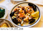 Frittura di mare - plate with various seafood. Italian food. Стоковое фото, фотограф Яков Филимонов / Фотобанк Лори