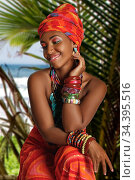 Black Woman in the national African dress gentle smiling against the background of nature. Стоковое фото, фотограф Алексей Кузнецов / Фотобанк Лори