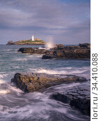Godrevy lighthouse at high tide, near Hayle, West Cornwall, UK. October 2019. Стоковое фото, фотограф Ross Hoddinott / Nature Picture Library / Фотобанк Лори