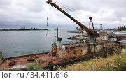 Old repair sea port with rusty ships against a dramatic sky. Стоковое видео, видеограф Алексей Кузнецов / Фотобанк Лори