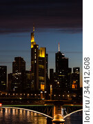 Germany, Frankfurt am Main - Skyline of the financial district in the city in the evening twilight with the headquarters of Commerzbank AG, in front of the Main. Редакционное фото, агентство Caro Photoagency / Фотобанк Лори