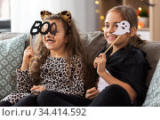 girls in halloween costumes with party props. Стоковое фото, фотограф Syda Productions / Фотобанк Лори