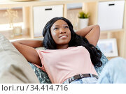happy african american young woman at home. Стоковое фото, фотограф Syda Productions / Фотобанк Лори