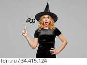 woman in halloween costume of witch with accessory. Стоковое фото, фотограф Syda Productions / Фотобанк Лори