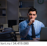 Businessman working late at night in overtime shift. Стоковое фото, фотограф Elnur / Фотобанк Лори