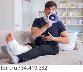 Man injured in car crash recovering at home from whiplash injury. Стоковое фото, фотограф Elnur / Фотобанк Лори
