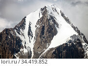 Mountain top with steep cliffs covered with snow and ice. Стоковое фото, фотограф Олег Елагин / Фотобанк Лори