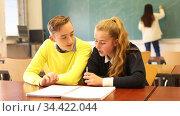 Two teenage students studying together in classroom. Education concept. Стоковое видео, видеограф Яков Филимонов / Фотобанк Лори