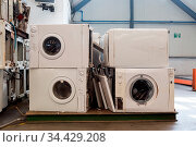 Piles of used and thrown away washing machines waiting to be recycled... Стоковое фото, фотограф Zoonar.com/Arthur Mustafa / easy Fotostock / Фотобанк Лори