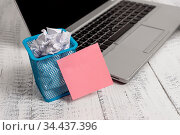 Metallic laptop sticky note pad waste basket crushed paper vintage... Стоковое фото, фотограф Zoonar.com/Artur Szczybylo / easy Fotostock / Фотобанк Лори