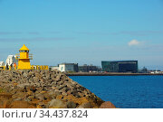 Summer sunny day and walk along the embankment in Reykjavik, the yellow... Стоковое фото, фотограф Zoonar.com/Sergei Aleliukhin / easy Fotostock / Фотобанк Лори