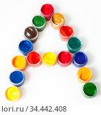 Colorful paints in plastic boxes in shape of A letter, white background. Стоковое фото, фотограф Кекяляйнен Андрей / Фотобанк Лори
